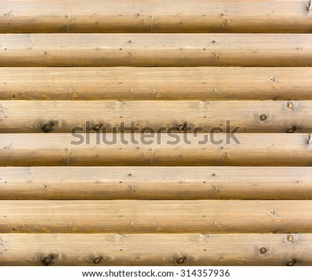 Seamlessly tiling wooden wall texture / Wooden wall from logs as a background texture - stock photo
