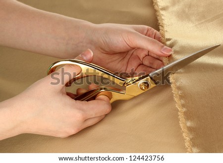 Seamstress cut gold fabric close-up