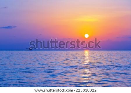 Seaplane at sunset - Maldives vacation background - stock photo