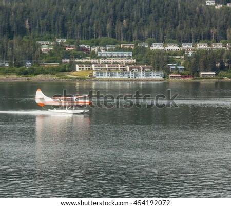 Seaplane in the harbor in the wilderness of Alaska - stock photo
