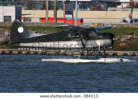 Seaplane taxing - stock photo