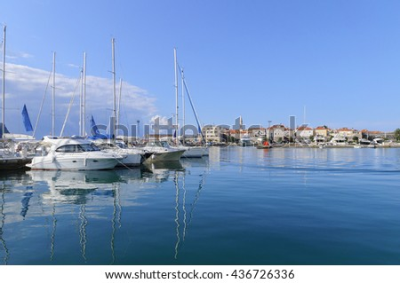 Seaport and yachts in the old town of Budva in sunny day, Montenegro - stock photo