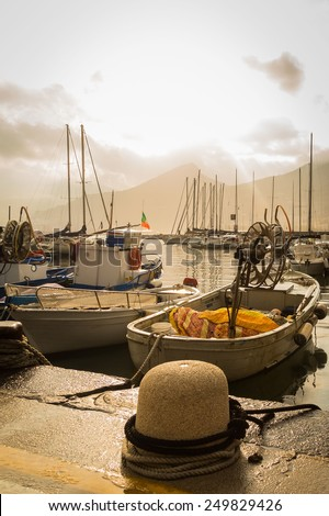 Seaport. Mediterranean seaport in cloudy weather. Yachts, boats, fishing boats on the dock. Private yachts and boats. Seascape. - stock photo