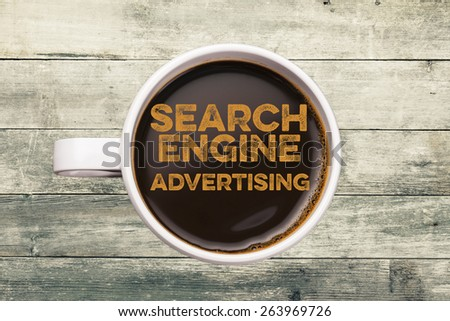 search engine advertising. coffee cup with wood background - stock photo