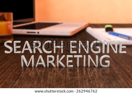 Search Engine Marketing - letters on wooden desk with laptop computer and a notebook. 3d render illustration. - stock photo