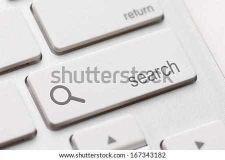 search enter button key on white keyboard - stock photo