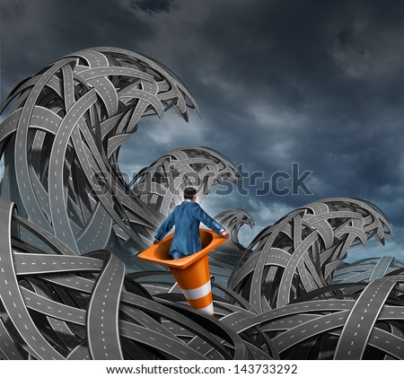 Search for direction business concept as a businessman floating in a traffic cone through a pile of tangled roads and highways shaped as high waves from an ocean storm as an icon of leadership. - stock photo
