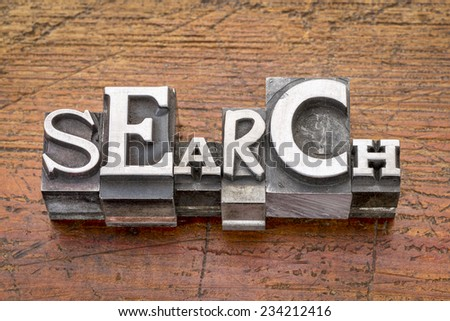 search  word in mixed vintage metal type printing blocks over grunge wood - stock photo