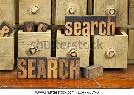 search word or SEO concept  - vintage letterpress wood type with primitive apothecary drawer cabinet