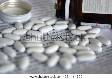searching for help, suicide with pills - stock photo