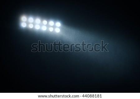 searchlight and rain - stock photo