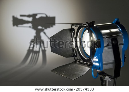 Searchlight and silhouette of the chamber. - stock photo