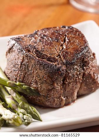 seared tenderloin steak with asparagus. - stock photo