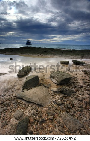 Seascape and rock with dramatic sky in Thailand - stock photo