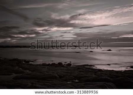 Seascape at dusk. Portuguese coast. Long exposure. Used infrared fltrer. - stock photo
