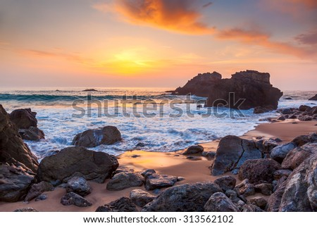 Seascape at Sunset time, the rocky coast, Portugal, Europe - stock photo