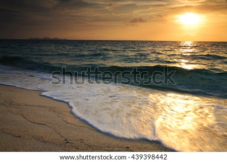 Seascape at sunset with motion wave, Travel and holiday symbol - stock photo
