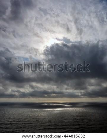 seascape, Atlantic ocean taken from the coast of Devon, UK. Stormy skies at sunset. - stock photo