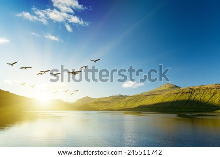 Seascape, mountains on the horizon. The Faroe Islands. The sunrise.