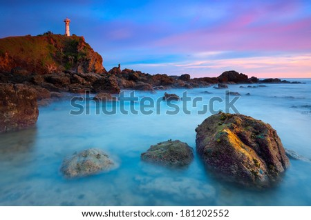 Seascape of Lighthouse in Twilight Moment - stock photo