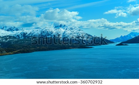 Seascape of Lofoten Islands in Norway with cloudy sky - stock photo