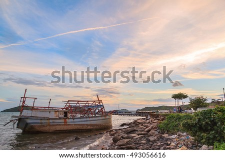 Seascape of sunset with dead fishing boat at Chonburi province, Thailand