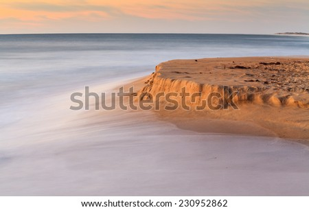 Seascape of the Atlantic ocean flowing in to shore and eroding the sandy beach on the Cape Hatteras National Seashore in the Outer Banks of North Carolina. - stock photo