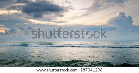 seascape on background of cloudy sky - stock photo