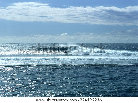 Seascape, windsurfer visible in distance - stock photo