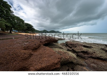 Seascape with a rock on foreground