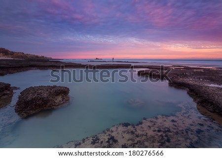 Seascape with beautiful red sunset. Portugal. - stock photo