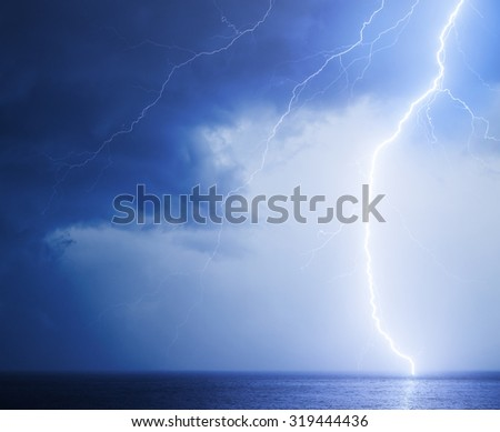 Seascape with bright lightning in dark blue sky  - stock photo