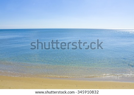 Seascape with calm blue sea, clean blue sky and sandy beach, recorded in Saint Constantine and Saint Helen resort, Bulgaria.