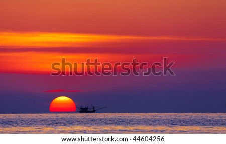 Seascape with fishing boat at sunset, Chang island, Thailand - stock photo