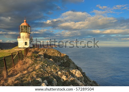 Seascape with lighthouse at Cape Rotary. The Far East. Russia.