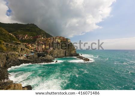 seascape with the sea hitting the mountain - stock photo