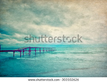 Seascape with wooden pier - retro style picture - stock photo