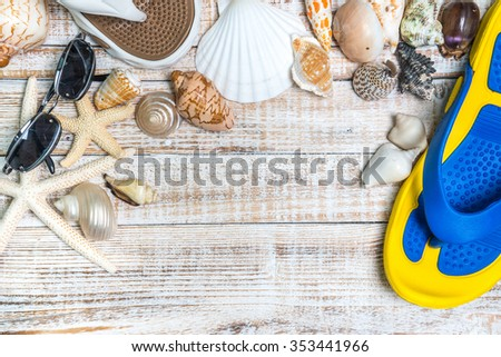 Seashell collection slippers and sunglasses on white background