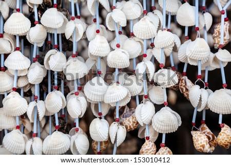Seashell decorations and souvenirs at market in Mamallapuram, Tamil Nadu, India - stock photo