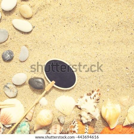 Seashells, sand and starfish background. Photo in vintage style - stock photo