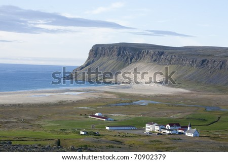 Seashore and farm in north west Iceland - stock photo