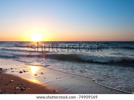 Seashore during bright sundown. Composition of the nature - stock photo