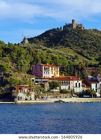 Seashore in the village of Collioure with windmill and castle in background, Mediterranean sea, Roussillon,Vermilion coast, France - stock photo