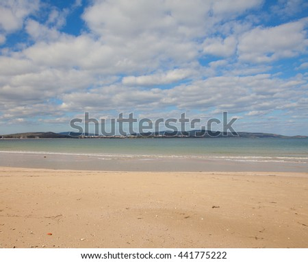 Seashore landscape with clean empty sandy beach and clear transparent water in town Kiten, Bulgarian sea resort, with a view to Primorsko coastline. Photo made in dead season, november - stock photo