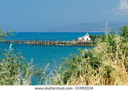 Seashore of Hersonissos, touristic place in Crete, Greece. - stock photo