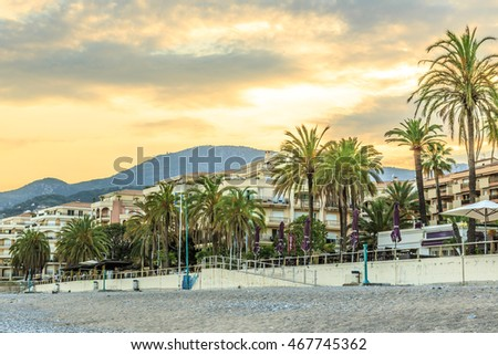 Seashore promenade in Menton against the mountains