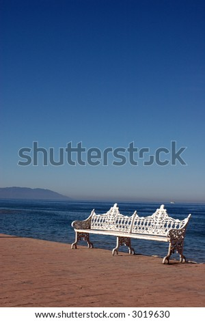 Seaside benches on the boardwalk in Puerto Vallarta Mexico - stock photo