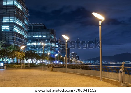Seaside Promenade of Harbor in Hong Kong city at night