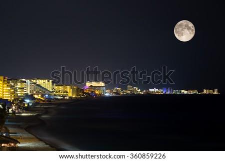 Seaside resorts along the coastline in the night - stock photo