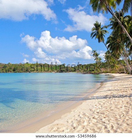 Seaside under blue sky with clouds. Luxury resort. - stock photo